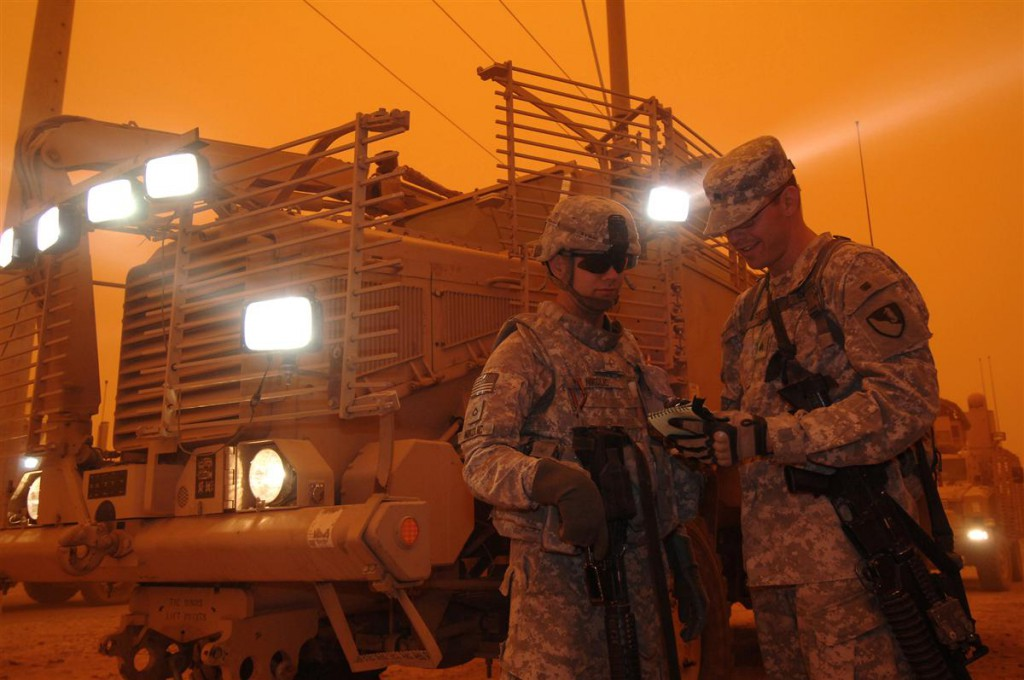 Members of the 573rd Clearance Company discuss mission details