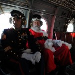 Santa Claus & Sgt. Iversen deliver Christmas gifts to children